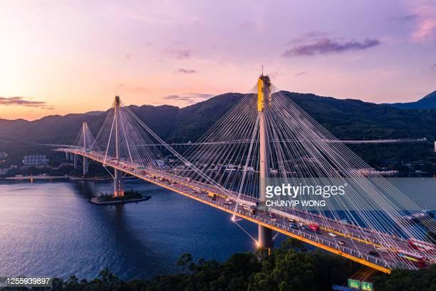 hong kong ting kau bridge in sunset - lantau stock pictures, royalty-free photos & images