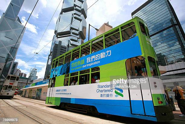 A Hong Kong tram with a Standard Chartered bank advertisment passes skyscrapers in downtown Hong Kong 07 August 2007 Standard Chartered the emerging...