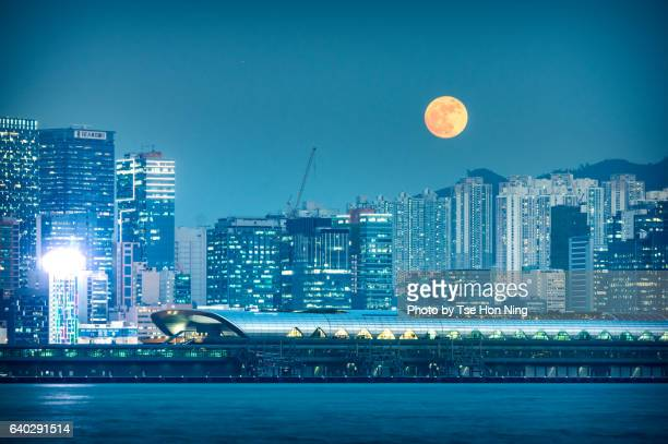 Hong Kong urban city skyline at night with supermoon