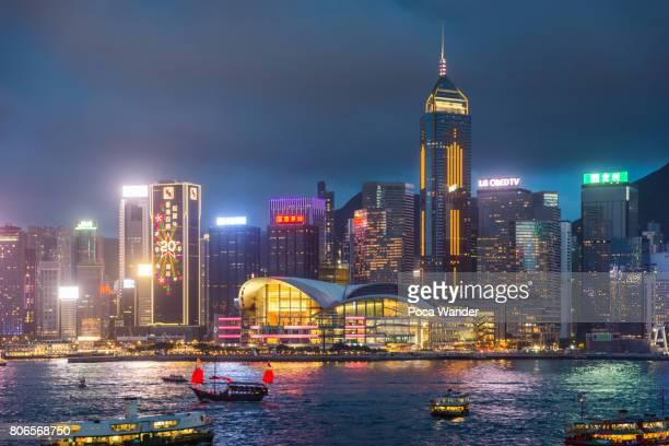 hong kong victoria harbor at night - wanchai stock photos and pictures