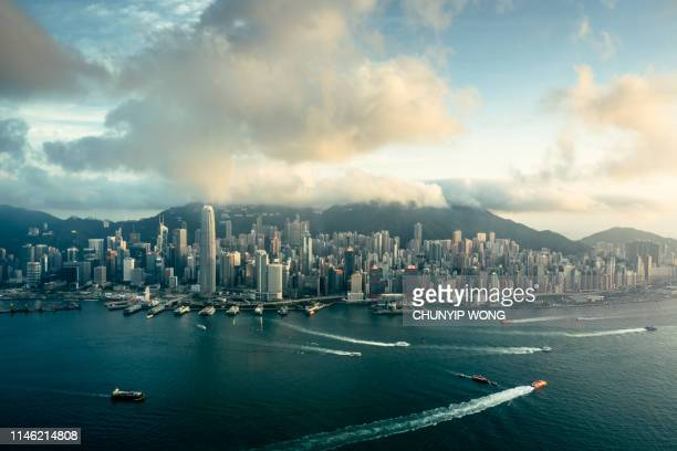 hong kong victoria harbor from air - cheung kong centre stock pictures, royalty-free photos & images