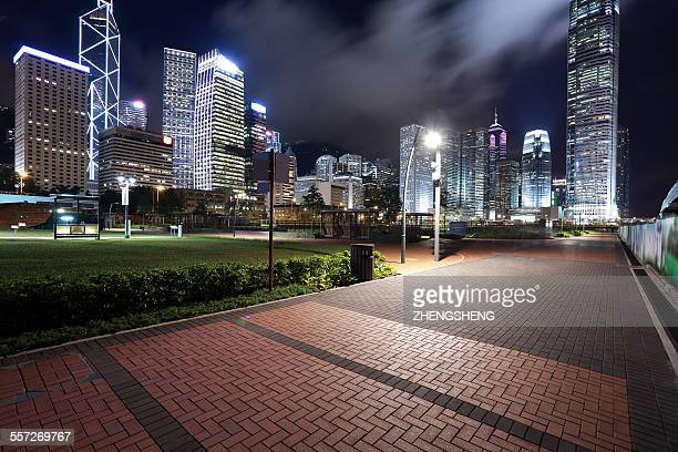 hong kong victoria harbour city landmark night - asphalt paving stock photos and pictures