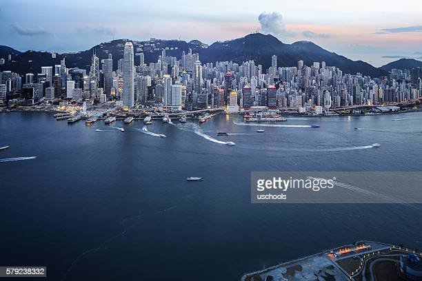 hong kong victoria harbour with cross-harbour tunnel - capital cities stock photos and pictures