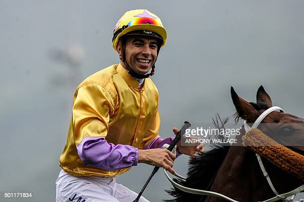 Hong Kongbased jockey Joao Moreira of Brazil celebrates as he approaches the presentation stage with Peniaphobia trained by Tony Cruz after winning...