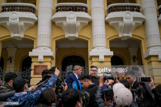 Hong Kongbased Kim JungUn impersonator 'Howard X' and Donald Trump lookalike 'Russell White' from Canada are seen posing for photos in front of Hanoi...