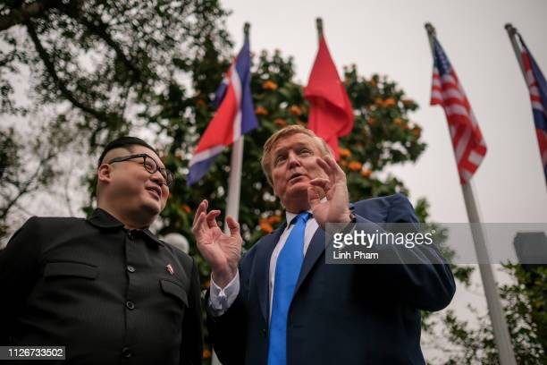 Hong Kongbased Kim JungUn impersonator 'Howard X' and Donald Trump lookalike 'Russell White' from Canada are seen walking around and posing for...