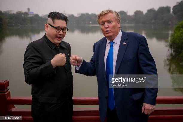 Hong Kongbased Kim JungUn impersonator 'Howard X' and Donald Trump lookalike 'Russell White' from Canada are seen visiting and posing for photos at...