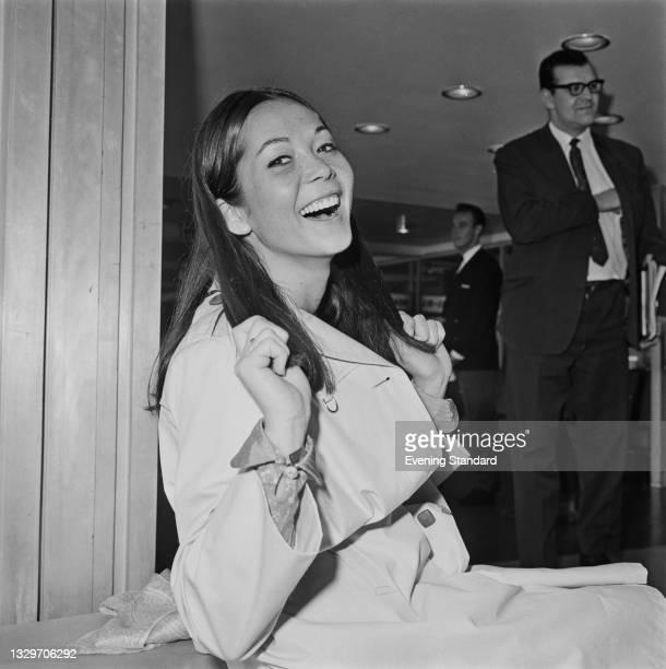 Hong Kong-born actress Nancy Kwan at London Airport in London, UK, 27th April 1965.