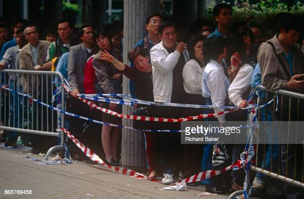 Hong Kongborn Chinese queue outside ImmigrationTower to apply for naturalisation as British Dependent Territories Citizens one year before the...
