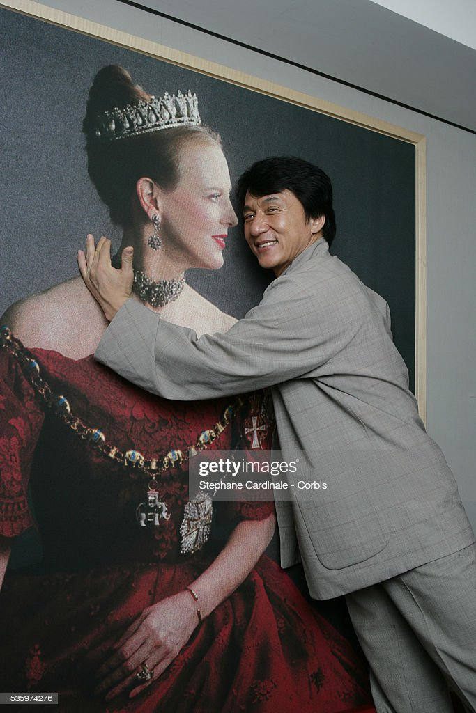 Hong Kong-born martial arts actor Jackie Chan attends the tribute gala in honor of French actress Jeanne Moreau at Flora Danica. Jackie Chan kisses a portrait of Denmark's Queen Margaret II.