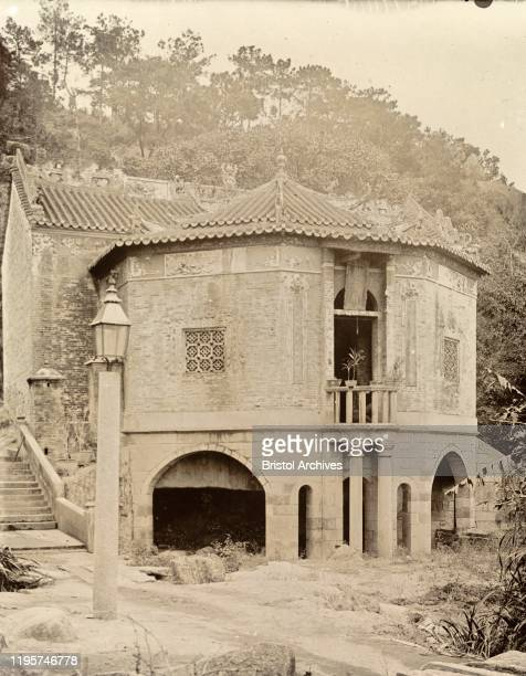 Hong KongChina A large apse supported by arches projects from the rear of a Joss house Original manuscript caption Joss House Hong Kong circa 1903...