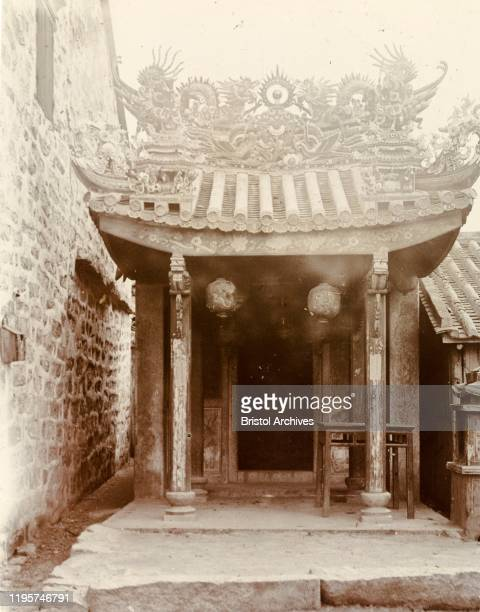 Hong KongChina An ornate pagodastyle roof adorned with religious idols decorates the doorway at the entrance to a 'Joss house' Original manuscript...