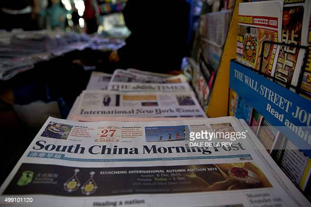 Hong KongChinamediaAlibabaSCMP FOCUS by Aaron Tam In this picture taken on November 28 copies of the South China Morning Post are displayed for sale...