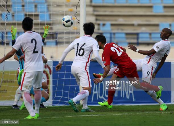 Hong Kong's Alessandro Ferreira Leonardo tries to defend as Lebanon's forward Mohamad Ghaddar scores a goal during the AFC Asian Cup qualifiers...