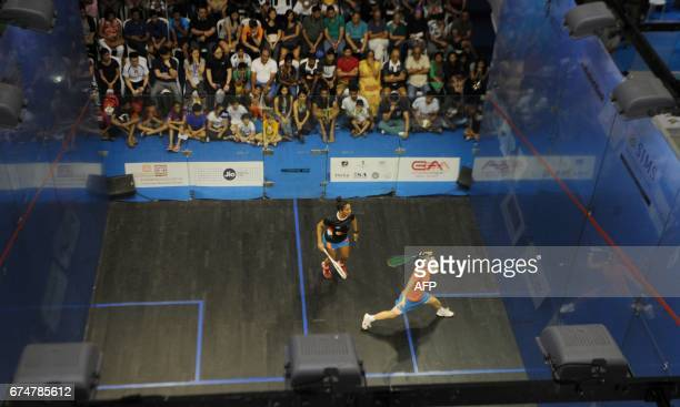 Hong Kong's Annie Au plays a shot to India's Dipika Pallikal during their women's semifinal match at the 19th Asian Squash Championship in Chennai on...