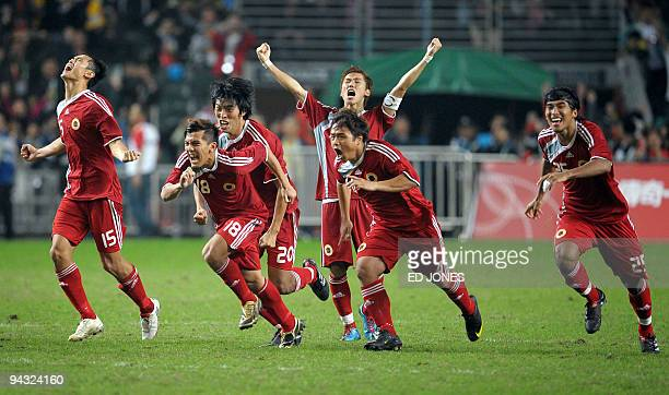 Hong Kong's Chan Wai Ho Kwok Kin Pong Chao Pengfei Au Yeung YiuCheung Yuen Kin Man and So Wai Chuen watch as they win a penalty shootout during their...
