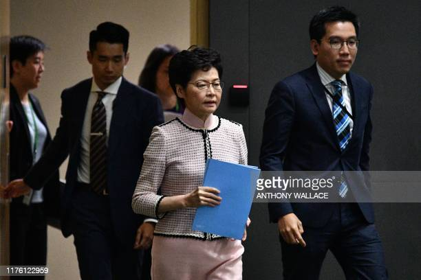 Hong Kong's Chief Executive Carrie Lam arrives to speak at a press conference in Hong Kong on October 16 after she tried twice to begin her annual...