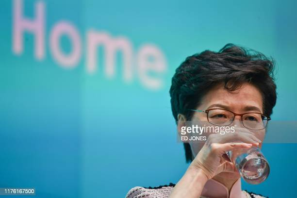 Hong Kong's Chief Executive Carrie Lam attends a press conference in Hong Kong on October 16 after she tried twice to begin her annual policy address...