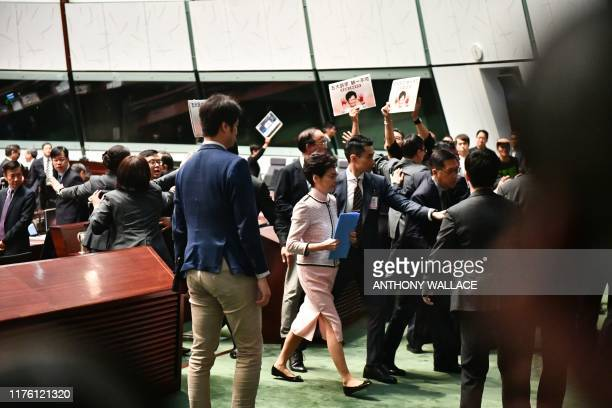 Hong Kong's Chief Executive Carrie Lam leaves the chamber for a second time while trying to give her annual policy address as she is heckled by...