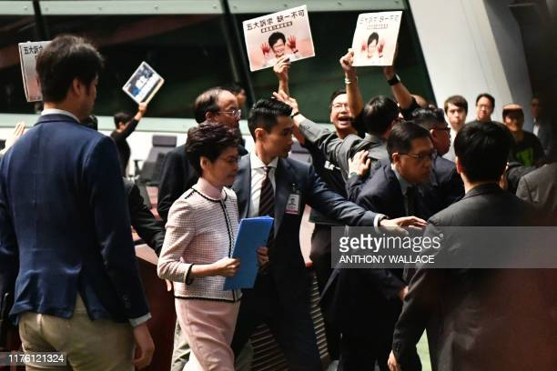 TOPSHOT Hong Kong's Chief Executive Carrie Lam leaves the chamber for a second time while trying to give her annual policy address as she is heckled...