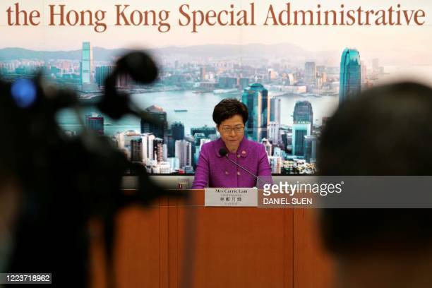 Hong Kong's Chief Executive Carrie Lam takes part in a press conference at the government headquarters in Hong Kong on July 1 on the 23rd anniversary...