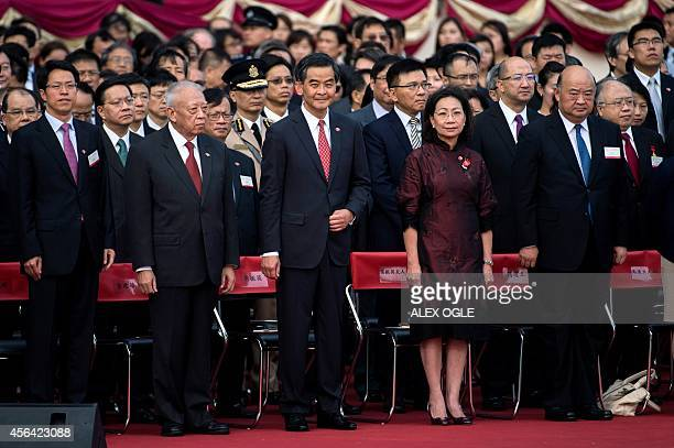 Hong Kong's Chief Executive Leung Chunying attends a flag raising ceremony to mark the 65th anniversary of the founding of Communist China along with...