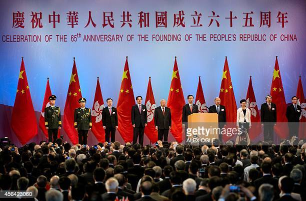 Hong Kong's Chief Executive Leung Chunying attends a reception to mark the 65th anniversary of the founding of Communist China in Hong Kong on...