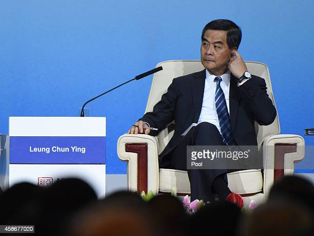 Hong Kong's Chief Executive Leung Chunying speaks as he takes part in a summit dialogue at the AsiaPacific Economic Cooperation summit at the China...
