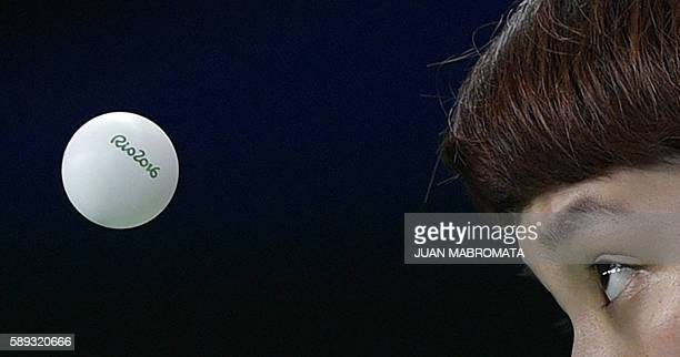 "Hong Kong's Doo Hoi Kem eyes the ""Rio 2016"" branded table tennis ball as she serves in the women's team quarter-final table tennis match against..."