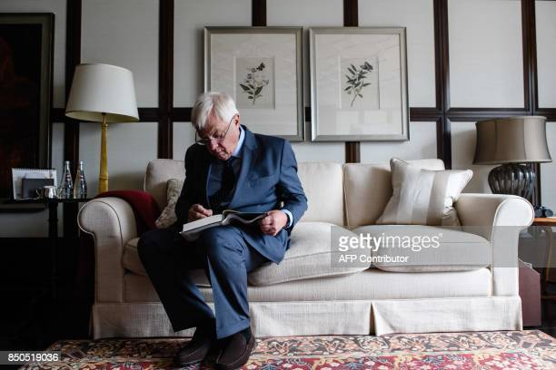 Hong Kong's former British colonial governor Chris Patten signs his new memoir First Confession after an interview with AFP at the harbourside...