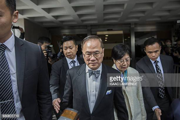 Hong Kong's former chief executive Donald Tsang leaves the High Court with his wife Selina Tsang during the first day of his corruption trial in Hong...