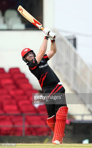 Hong Kong's Jamie Atkinson plays a shot during the opening match of the ICC World T20 cricket tournament between Hong Kong and Zimbabwe at The...