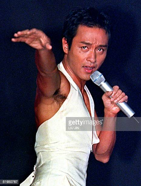 Hong Kong's king of pop singer Leslie Cheung performs on the stage during a concert at Shanghai Stadium late 16 September 2000 Cheung retired from...