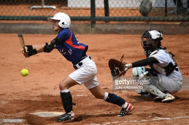 Hong Kong's Lam Puikwan bats during the women's preliminary softball match between Hong Kong and Japan at the 2018 Asian Games in Jakarta on August...