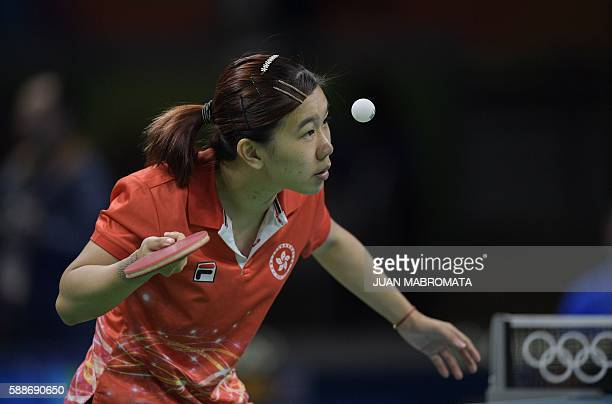 Hong Kong's Lee Ho Ching eyes the ball as she serves in the women's team qualification round table tennis match against Taiwan's Cheng IChing at the...