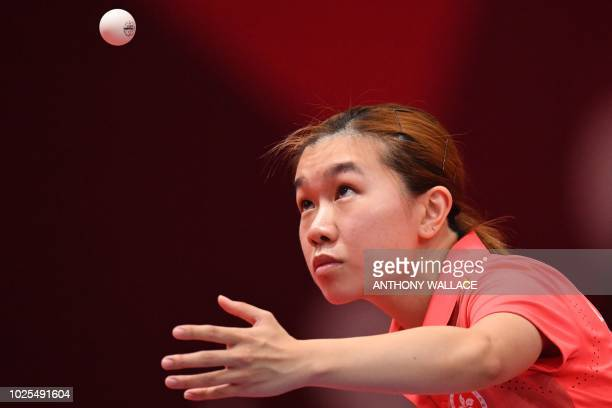 Hong Kong's Lee Ho Ching hits the ball to China's Chen Meng during their women's quarterfinal table tennis match at the Asian Games in Jakarta on...