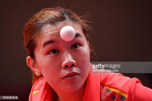 Hong Kong's Lee Ho Ching serves against China's Chen Meng during their women's quarterfinal table tennis match at the Asian Games in Jakarta on...