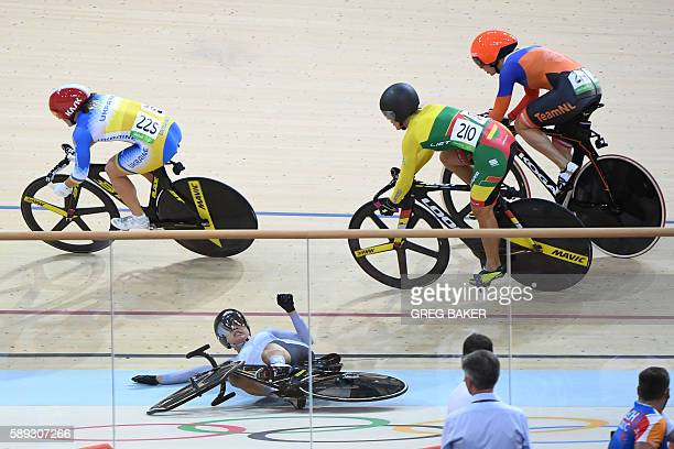 TOPSHOT Hong Kong's Lee Wai Sze falls during the women's Keirin second round track cycling event at the Velodrome during the Rio 2016 Olympic Games...