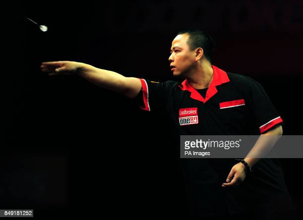 Hong Kong's Leung Chun Nam in action during the Ladbrokescom World Darts Championship at Alexandra Palace London