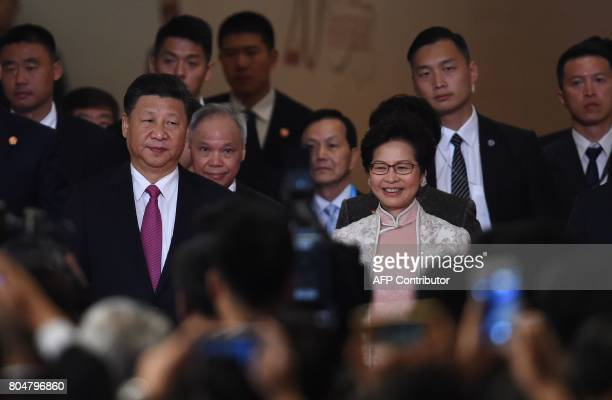 Hong Kong's new Chief Executive Carrie Lam arrives with China's President Xi Jinping before being sworn in as the territory's new leader at the Hong...