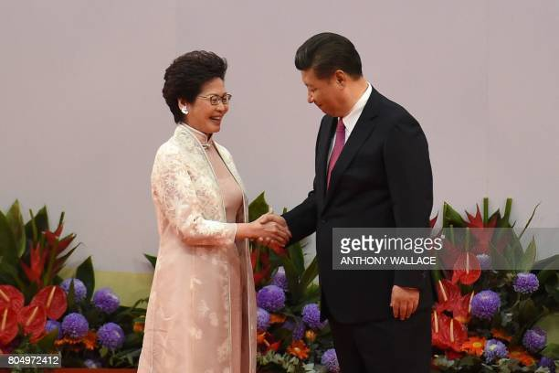 Hong Kong's new Chief Executive Carrie Lam shakes hands with China's President Xi Jinping after being sworn in as the territory's new leader at the...