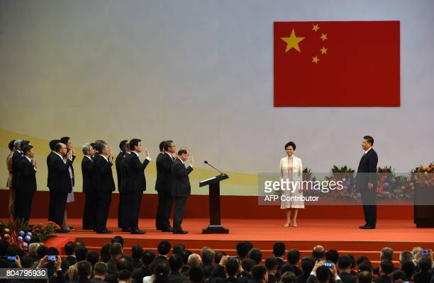 Hong Kong's new Chief Executive Carrie Lam stands with China's President Xi Jinping as her ministers are sworn in during a ceremony at the Hong Kong...