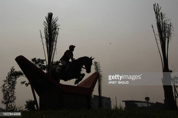 Hong Kong's Nicole Michele Fardel competes in the eventing team and individual cross country event at the equestrian competition at the 2018 Asian...