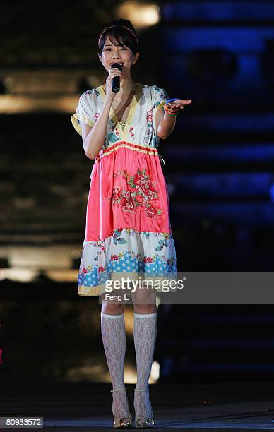 Hong Kong's pop singer Karen Mok performs during the Award-giving Ceremony for the 4th Olympic Songs Competition at the illuminated Worker People's...