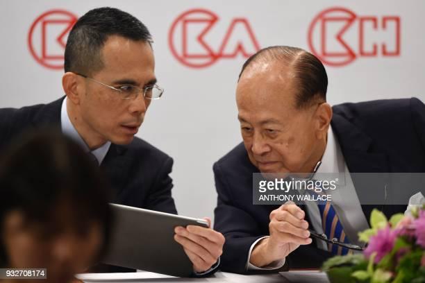 Hong Kong's richest man Li Kashing and his son Victor attend a press conference in Hong Kong on March 16 2018 Hong Kong's richest man Li Kashing...