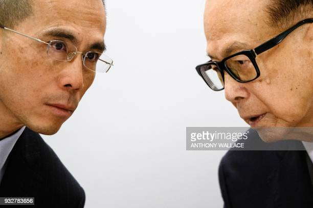 Hong Kong's richest man Li Kashing and his son Victor speak during a press conference in Hong Kong on March 16 2018 Hong Kong's richest man Li...