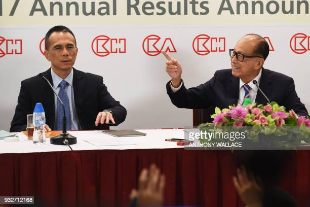 Hong Kong's richest man Li Kashing gestures beside his son Victor during a press conference in Hong Kong on March 16 2018 Hong Kong's richest man Li...