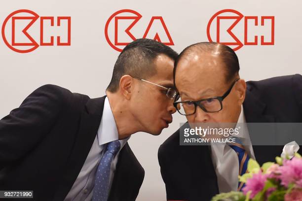 Hong Kong's richest man Li Kashing listens to his son Victor during a press conference in Hong Kong on March 16 2018 Hong Kong's richest man Li...