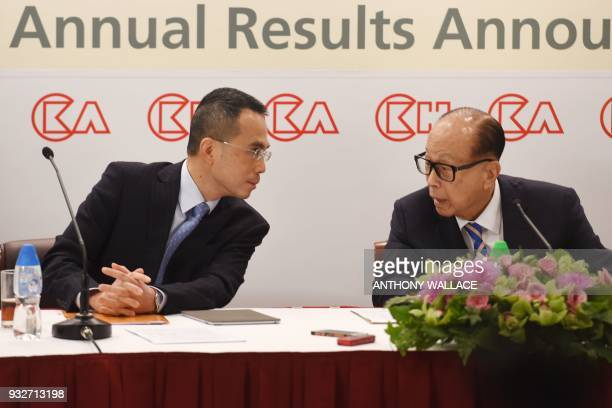 Hong Kong's richest man Li Kashing speaks to his son Victor during a press conference in Hong Kong on March 16 2018 Hong Kong's richest man Li...