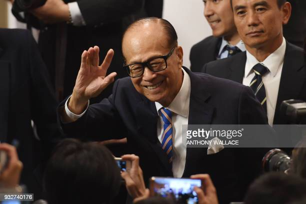 Hong Kong's richest man Li Kashing waves as he leaves a press conference in Hong Kong on March 16 2018 Hong Kong's richest man Li Kashing announced...